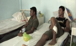 Marine Privates First Class Alvin Lovido (left) and John Paul Mangaoang recuperate at a military hospital after surviving three days adrift at sea, during which they were attacked by 'small' sharks. (photo by Elmer Badilla, InterAksyon.com)